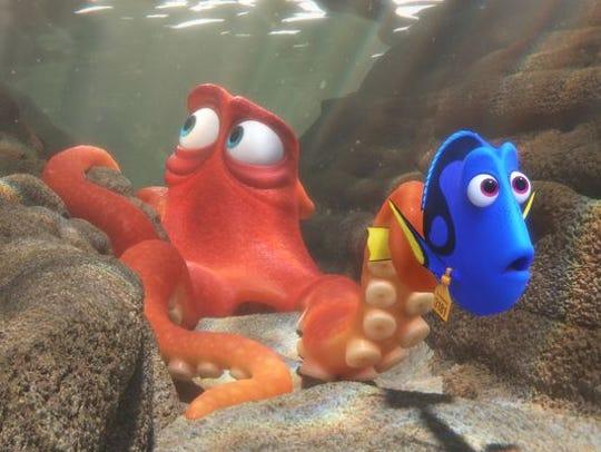 Hank (voiced by Ed O'Neill) befriends Dory (Ellen DeGeneres)