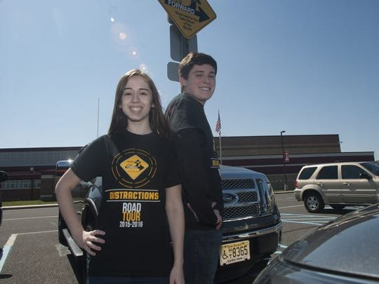 Lenape students Samantha Goldstein, left and Maxwell Bass stand near the Heads Up parking space at Lenape HIgh School. Students from the Lenape Regional High School District are participants in the Heads Up, Eyes Forward campaign that was started in the district in 2010-11. It's a safe driving program that encourages people to not be distracted drivers. The program won the grand prize for the fifth time in six years in a state contest.