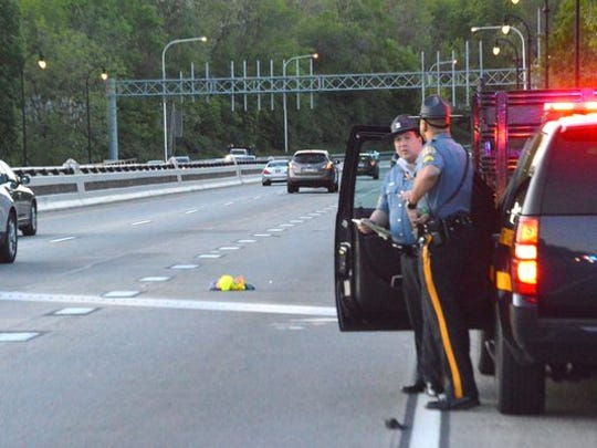 Delaware State Police on May 16 respond to Interstate 95 at the Brandywine River Bridge in Wilmington, where a highway worker was fatally struck. Highway fatalities have increased in Delaware as gas prices have plunged.