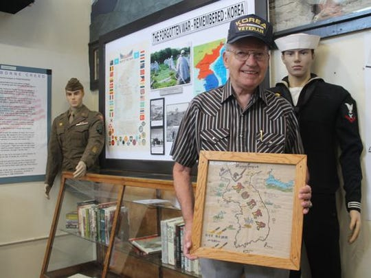 Frank Enyeart, who served in the Navy during the Korean War from 1950 to 1953, donated this display for the Tularosa Basin Museum of History's exhibit.
