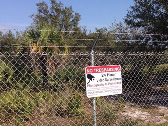 A sign on the perimeter of the would-be site of a controversial