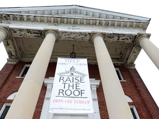 """Trinity held a """"Raise the Roof"""" fund drive to support efforts to restore the now 100-year-old church building. The church was challenged to raise $50K in 12 weeks to receive a matching donation from a generous donor."""