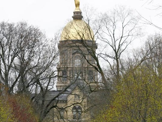 Students walk across the Notre Dame campus on Monday,