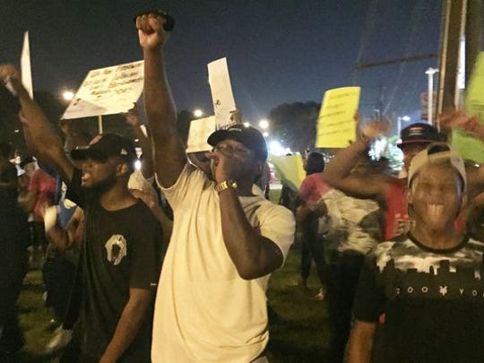 Demonstrators protest in Baton Rouge Friday over the