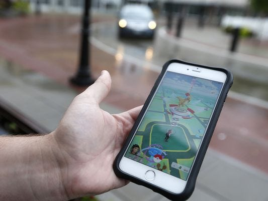 A player shows the gym located at Park Central Square in the Pokemon Go game.