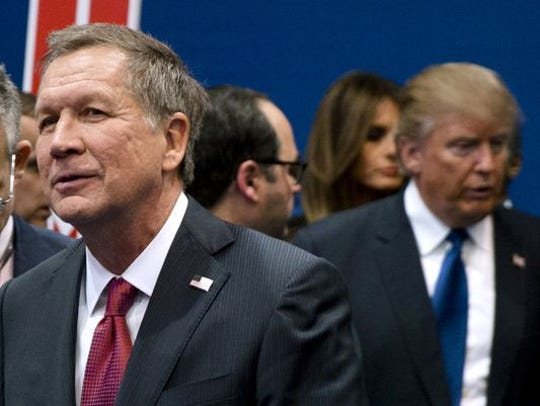 Ohio Gov. John Kasich, left, is feuding with GOP nominee