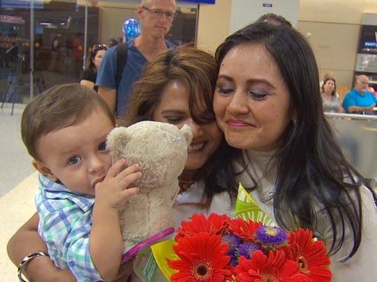 Mercy Casanellas, right, is reunited with her son, Moses, as they return home to Dallas.