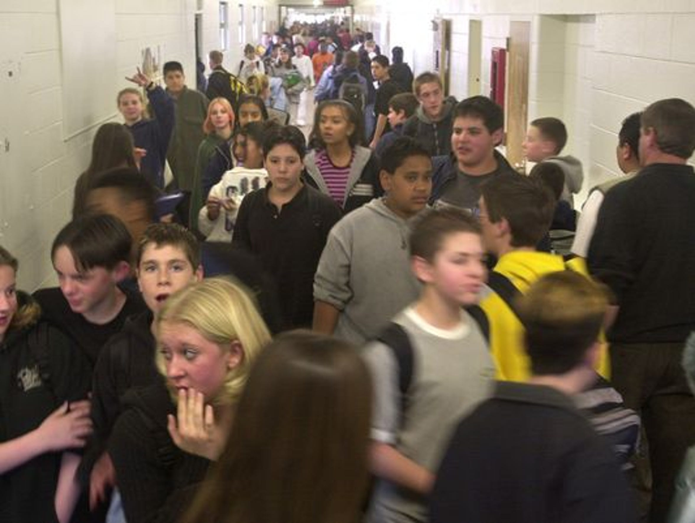Students at Sparks Middle School crowd the hallways