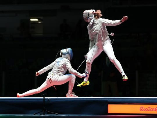 Monica Aksamit (right) competes for the U.S. in the