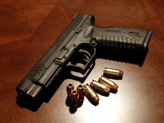 636077072268529043-gun.jpg