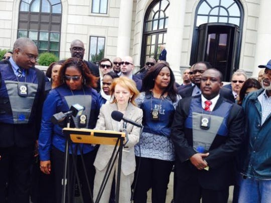 Parole officers and their lawyers announce lawsuit