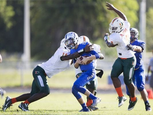 Ida Baker quarterback Toby Noland is sacked by a Dunbar pass rusher on Saturday. The Bulldogs lost 25-7 to the Tigers