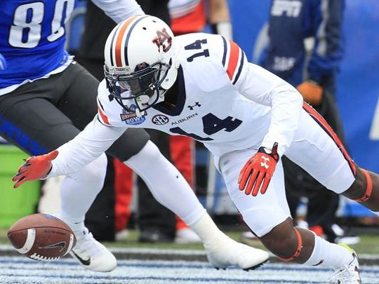 Auburn Tigers defensive back Stephen Roberts (14) falls on the ball after it was blocked when Memphis Tigers attempted a field goal in the 2015 Birmingham Bowl at Legion Field. Roberts is suspended for Saturday's season opener vs. No. 2 Clemson after being arrested on a gun charge.