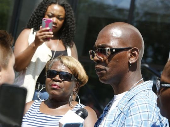Linda Hines, left, and Ricky McDuffie, parents of Ashley McDuffie, speak to the media after the arraignment of Jason Myers on Aug. 29.
