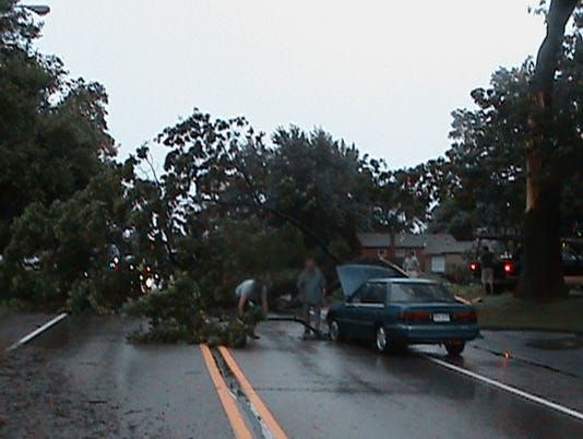 636089473065723087-storm-damage-file-photo.jpg