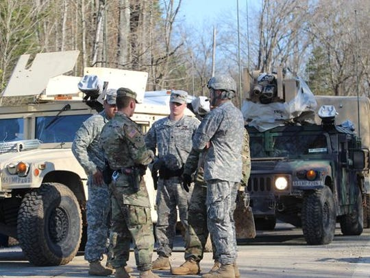 Military police set up a perimeter at a helicopter crash site in Montgomery County in December.