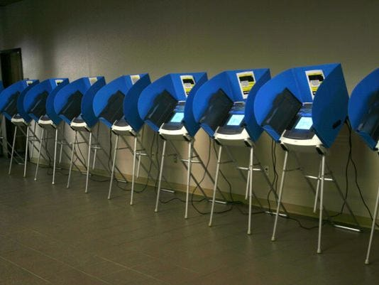 636114357583021393-voting-machines.jpg