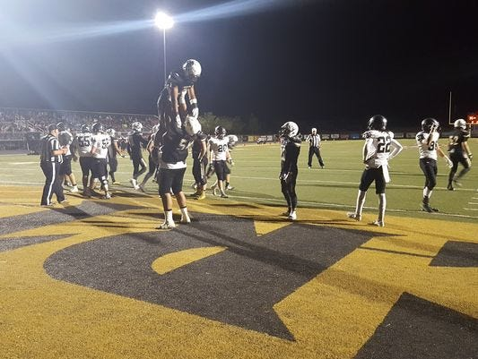 Desert Hills players celebrate a touchdown against Pine View on Friday. Nephi Sewell ran for 181 yards and two touchdowns in the win.