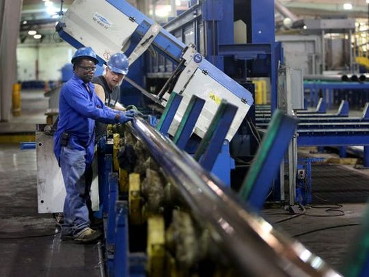 Albert Loveberry (left) and Martin Bass measure pipe at the Schulz Xtruded Products facility in Hernando.
