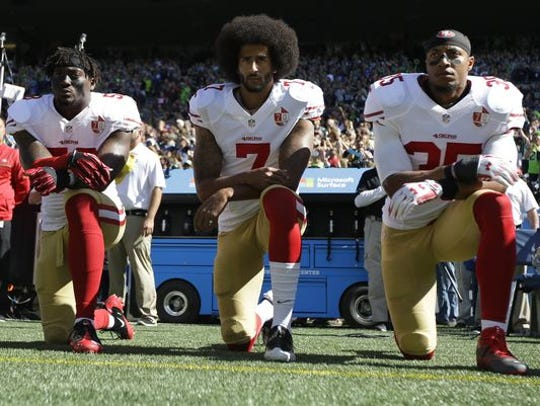 From left, San Francisco 49ers' Eli Harold, Colin Kaepernick