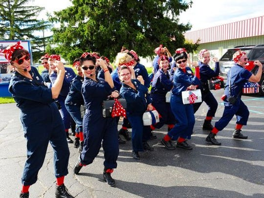 Rosie the Riveters strike a pose during a recent rehearsal for the annual Thanksgiving Parade in Detroit.