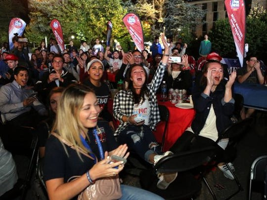 Will your party be as much fun as this one? Hofstra University students at an outdoor debate watch party.