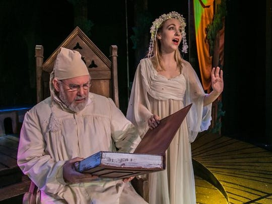 """Ebenezer Scrooge (John Patrick Cleary) faces the Ghost of Christmas Past (Cara Ganski) in the 2015 production of """"A Christmas Carol."""""""