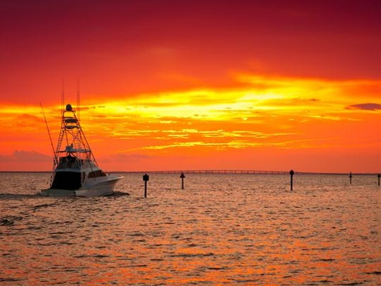 Large fishing boat going out for a sunset cruise in