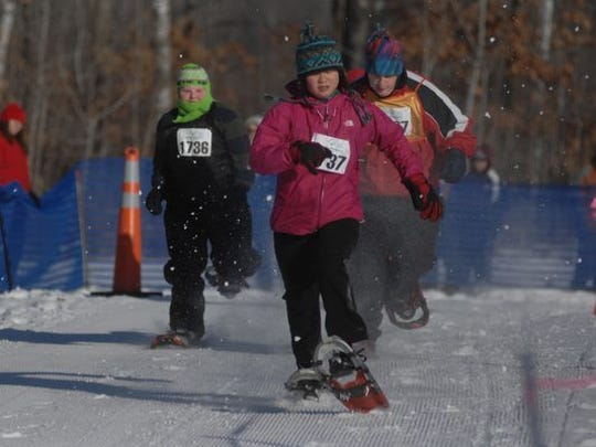 Noah Loveless, from left, Olivia Quigley and Jarvis Warwick compete in 2012 in a snowshoe race during the Special Olympics Wisconsin State Winter Games at Nine Mile County Forest Recreation Area in Rib Mountain.