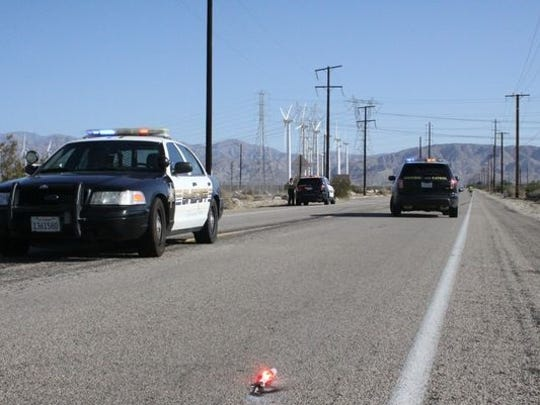 California Highway Patrol officers investigate the death of Desert Hot Springs resident Richard Helton, who  was found along Indian Canyon Drive July 3. He was one of 28 pedestrians killed across the Coachella Valley this year.