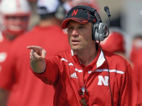 Nebraska head coach Mike Riley points during the annual