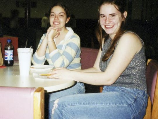 Caitlan Coleman, right, is pictured with her friend