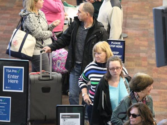 Passengers pass through security at Westchester County