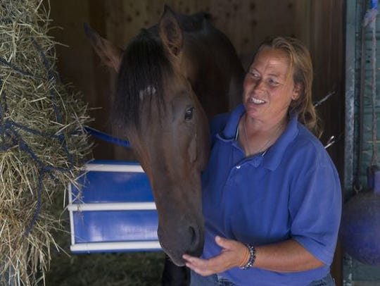 Monmouth Park trainer Linda Simon, with Play It Again,