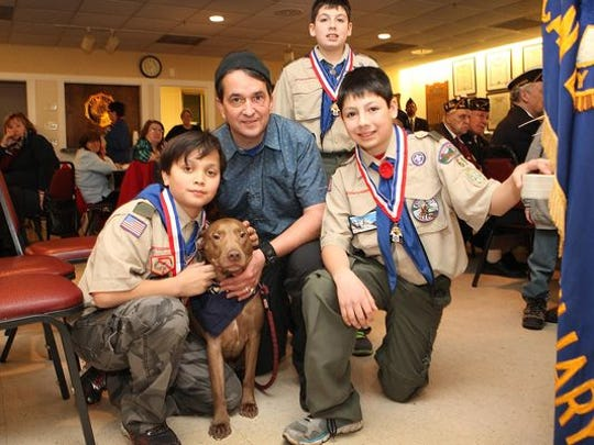 From left, Michael Petronino holding his dog Adobo;
