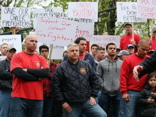 Port Chester career firefighters and supporters protest on May 3, 2016 after the village elminated the paid fire department.