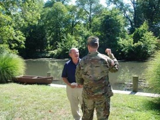 U.S. Sen.Bob Menendez, D-N.J., and U.S. Army Corps of Engineers Col. David Caldwell discuss the flood mitigation options while standing along the banks of the Rahway River behind the Cranford Canoe Club last year.