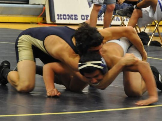 Sophomore Jorge Medina battles for third place in the