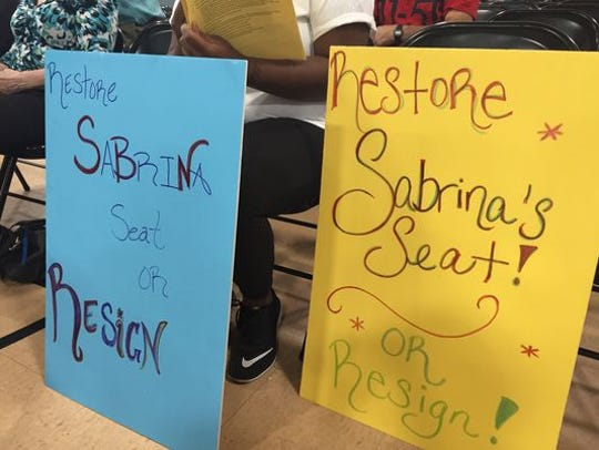 Signs at an East Ramapo school board meeting following