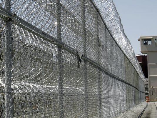 636204981210876873-prison-stock-photo-1-1-O2C6H457-L689516010.JPG