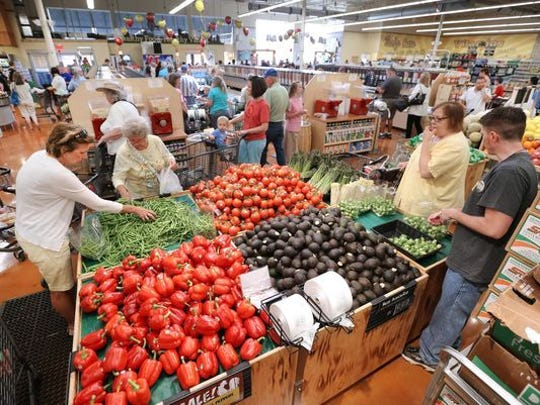 A Fresh Thyme Farmers Market in Greenwood, Ind., drew a crowd to check out the new store in June 2014.