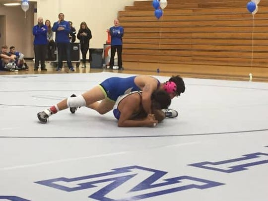 Reed senior Israel Casarez was named Middle Weight Wrestler of the Year