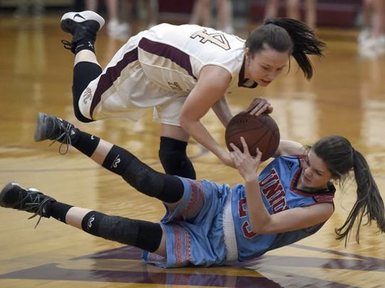 Jamie Winstead of Webster County and Courtlyn Beaven of Union County go after a loose ball during the Girls district 6 game at Webster County High School in Dixon Monday.