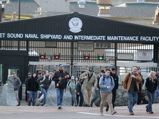 Employees at the Puget Sound Naval Shipyard exit the gate near the Bremerton ferry terminal in this undated photo. The Suquamish Tribe's construction arm has won an up-to-$99 million contract for projects, including a rebuild of the fencing around the shipyard.