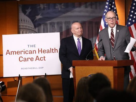 Reps. Kevin Brady, R-Texas, left, and Greg Walden, R-Ore., discussing the Republicans' new health care legislation on Tuesday.