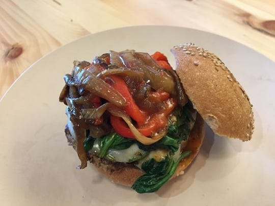 A b.good burger topped with healthy veggies.