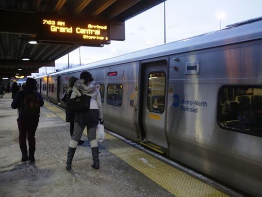 Commuters head for the Metro-North train to Grand Central