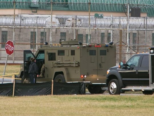 Officers respond to a siege at Vaughn prison near Smyrna in February.