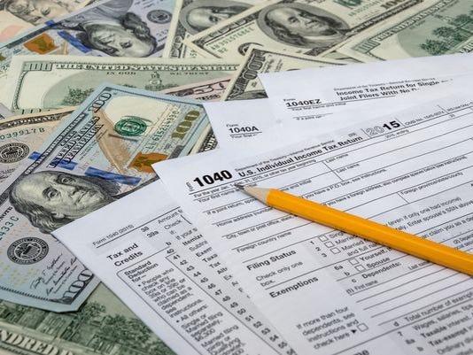 636283053760369288-taxreform.jpg