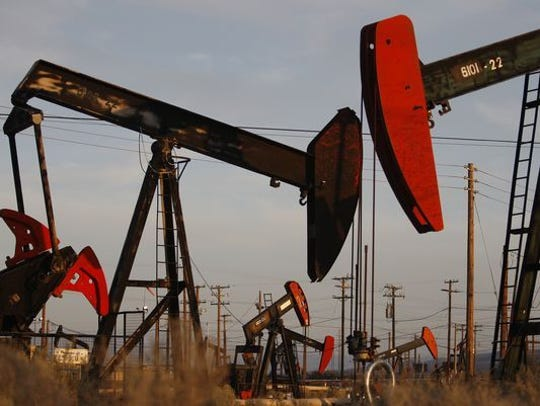 Pump jacks and wells are seen in an oil field on the